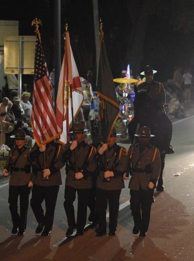 Participants make their way to downtown Fort Myers along US-41 during the Edison Festival of Light Grand Parade on Saturday, February 21, 2015.