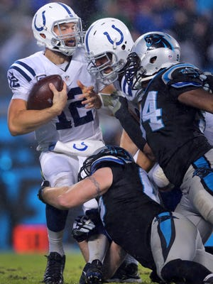 Indianapolis Colts quarterback Andrew Luck (12) is sacked during the second half of an NFL football game Monday, Nov. 2, 2015, at Bank of America Stadium in Charlotte, North Carolina.