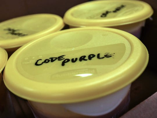 Volunteers bring in containers of beef and vegetable soup to serve to those seeking refuge from the cold at Friendship House in Wilmington. A group in Middletown is using the Friendship House model with its Code Purple effort.
