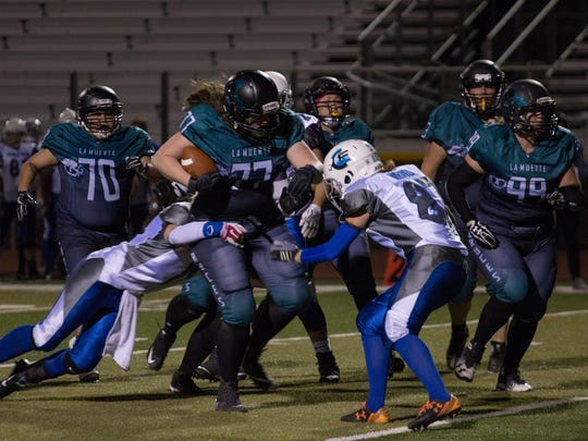 Jami Graham pushes through the Colorado Freeze defensive line Saturday night at the Field of Dreams at the La Muerte Football game on April 7, 2018.