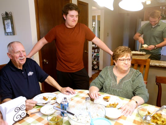 Jim (left) and Linda Frentz finish up their meal as their grandson, Jared Frentz, 16, talks with the group while the other grandson, Jordan Frentz (rear right) gets dessert.
