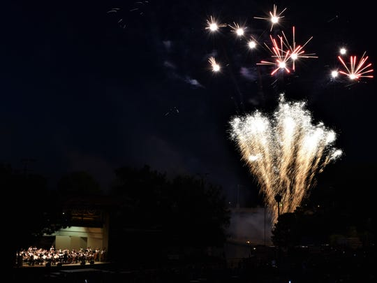 Fireworks sparkled in the evening sky as the San Angelo Symphony Orchestra played  on July 3, 2018 at the 2018 July 3rd Pops Concert.