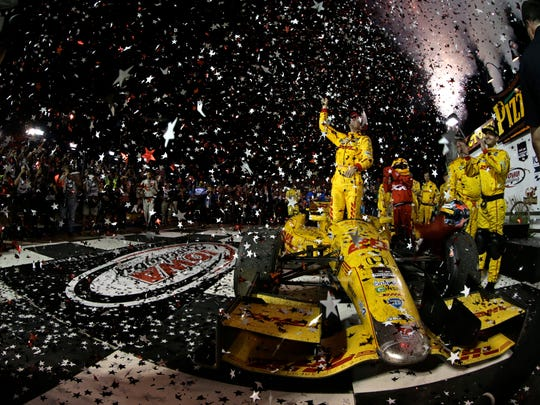 Ryan Hunter-Reay celebrates his 2013 Iowa Speedway win in Victory Lane.