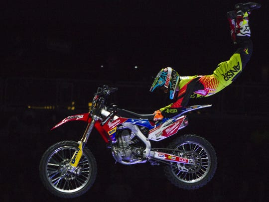 A FMX biker does a trick during the Nitro Circus show.
