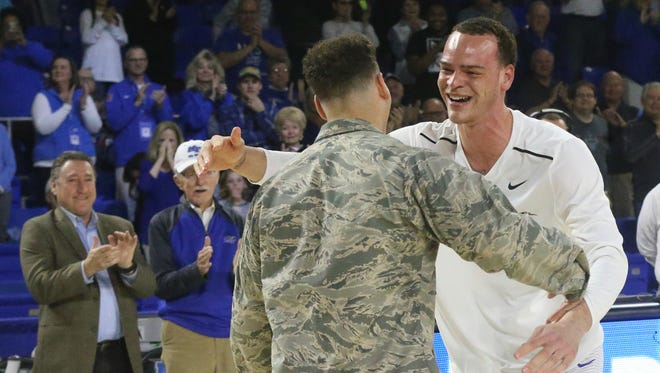 MTSU's Reggie Upshaw Jr. (30) is surprised by his brother Chase Upshaw during the the senior day recognition before the game against Florida Atlantic on Saturday, March 4, 2017.