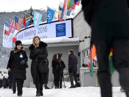 Participants walk outside the Congress Center on the