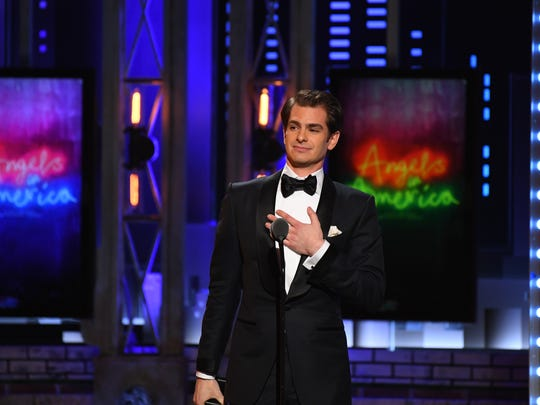 "Andrew Garfield accepts the award for best performance by an actor in a leading role in a play for ""Angels in America."""