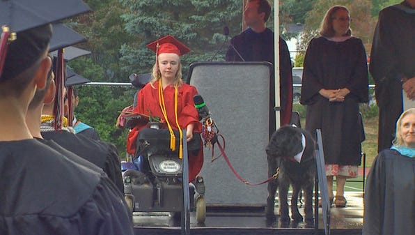 17-year-old Kayla Wheeler and her service dog, Cadet