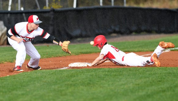 Ryan Singleton attempts to catch the ball as Franklins'