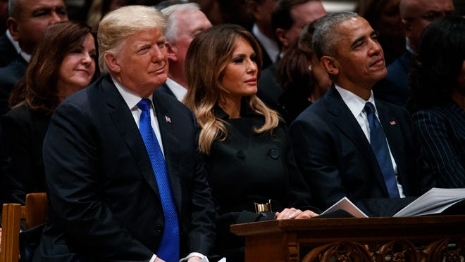 First lady Melania Trump sat in the front pew next to her husband and the president he replaced, former POTUS Barack Obama, at the state funeral for former President George H.W. Bush at the National Cathedral, Wednesday, Dec. 5, 2018, in Washington.