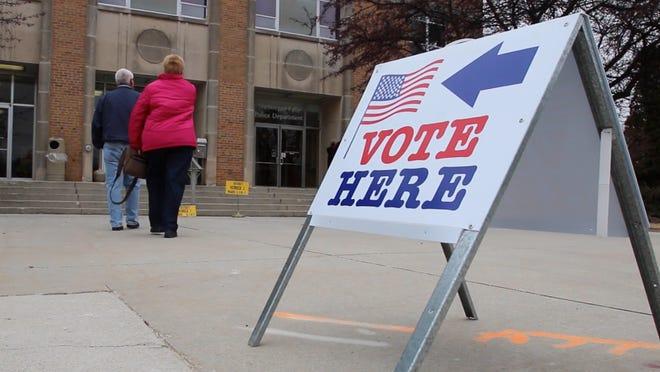 People enter to vote at the Sheboygan Falls Municipal Building April 1in Sheboygan Falls.