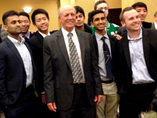 Novi coach Jim Hanson (center) was recently inducted