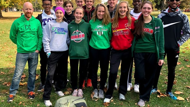 The LCHS Cross Country team poses for a photo while at the Sectional competition in Olney. From left in front: Becca Heitzig, Hattie Mourning, Caroline Ahrends, Reese McCuan and Abby Stiefvater. Middle row: Coach Heit, Dylan Gowin, Brenden Heitzig, Garrett Slack, Drake Rutledge, Aiden Gowin and Jalen Franz. Back row: Ethan Bivin and Jake Bivin.