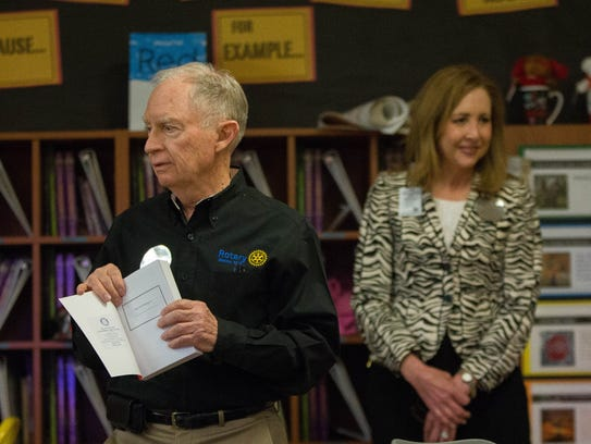 Robert Sheldon, chairman of the dictionary program for the Rio Gande Rotary Club, presents a batch of dictionaries to third-grade students at Monte Vista Elementary School during dictionary day, Tuesday, March 27, 2018.