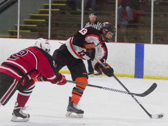 Brighton's Kyle Cogan takes a shot while being defended by Canton's Joseph Powers.