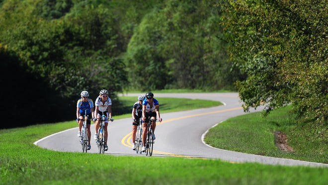 Cyclists ride on the Natchez Trace Parkway in Williamson County.