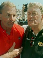 Iowa State football coach Dan McCarney talks with Hayden