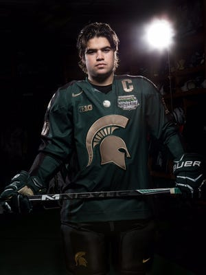 Michael Ferrantino models the alternate uniform that MSU will wear in the Hockey City Classic against Michigan on Feb. 7 at Soldier Field in Chicago.