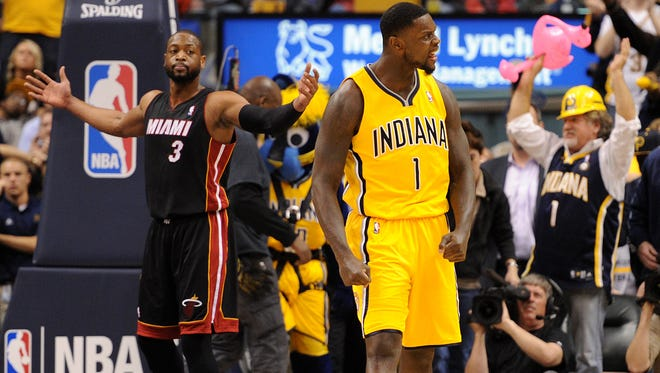 Indiana Pacers guard Lance Stephenson receives his second technical foul of the game as Miami Heat guard Dwayne Wade gestures under the basket inside Bankers Life Fieldhouse, Wednesday, March 26, 2014, in Indianapolis. The Pacers won the game 84-83.