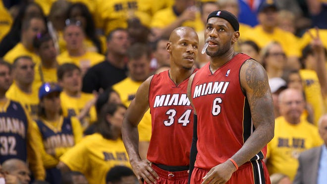 Miami Heat forward LeBron James and Heat guard Ray Allen walk up court during the second half of action. Indiana Pacers play the Miami Heat in Game 1 of the NBA Eastern Conference Finals May 18, 2014 at Bankers Life Fieldhouse. The Pacers defeated the Heat 107-96.