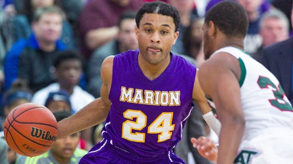 Marion High School senior James Blackmon Jr. (24) drives the lane during the first half of varsity basketball action in a game of Indiana's Best Showcase at Marshall High School Dec. 23, 2013.