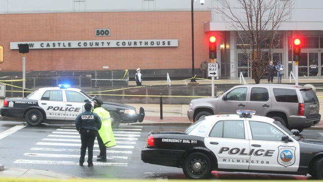 Authorities gather outside the New Castle County Courthouse after a shooting with multiple injured victims, Monday morning, Feb. 11, 2013.