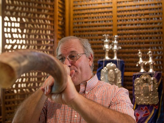 Rabbi Jack Romberg of the Temple of Israel sounds the