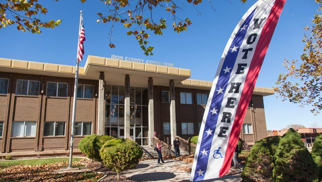 "A ""Vote Here"" banner sits outside the Iron County Courthouse in Parowan on Election Day, Tuesday, Nov. 8, 2016."