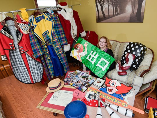 Pat Cashin, a former nationally renown circus clown and a sought-after Santa Claus died on July 24, 2016. Here, his wife Terry Cashin can't help but laugh as she displays some of Pat's outfits, gadgets and pictures, including a banner from he performed in China.