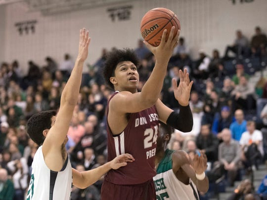 Don Bosco's Ronald Harper puts in two points helping to hold off Camden during closing minutes of game. Don Bosco  vs Camden Catholic  boys basketball in NJSIAA Non-Public A final in Toms River on March 10, 2018