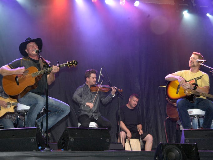 Tracy Lawrence (far left) performs Sunday, July 20, 2014 evening with Craig Morgan on Main Street in downtown Dickson.