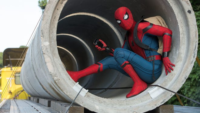 """Tom Holland suits up as the title hero in """"Spider-Man: Homecoming."""""""