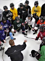 St. Cloud Icebreakers head coach Mark Chamernick directs girls from Apollo, Cathedral and Tech in 2010 at the Municipal Athletic Complex.