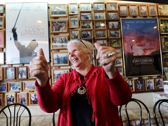 """Elizabeth """"Betsy"""" Hower of Gettysburg demonstrates how Donald Trump gave her a personal thumbs up when he came to Gettysburg to deliver his policy address before the election in October 2016. He praised her for handing out more than 3,000 Trump for President signs. She is in the lobby of Picket's Charge Buffet, a restaurant adjacent to the area of the battlefield where Pickets Charge took place."""