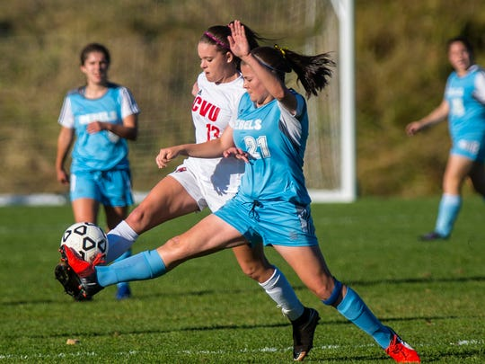CVU's Chalotte Hill, left, and South Burlington's Jessica Burt foot the ball in Hinesburg on Tuesday, October 11, 2016.