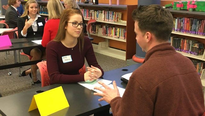 A Forest Hills high school student is interviewed by a community volunteer at the Interviewing Skills class sponsored by the Forest Hills Foundation for Education.