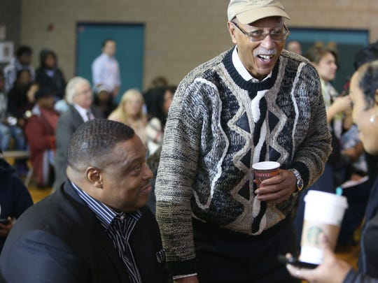 Former Pistons Rick Mahorn, left, and Dave Bing before the dedication of the new basketball court in the S.A.Y. Detroit Play Center at Lipke Park in Detroit on Monday, January 18, 2016.