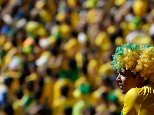 A Brazil soccer fan watches his team's World Cup round of 16 match against Chile at Mineirao Stadium in Belo Horizonte, Brazil, Saturday, June 28, 2014. Brazil won the match 3-2 on penalties after the match ended 1-1. (AP Photo/Petr David Josek)
