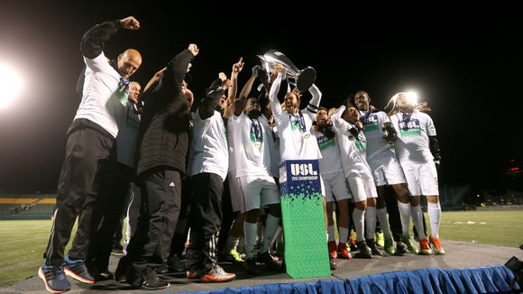 Rochester Rhinos players celebrate with the USL Championship trophy after beating the LA Galaxy ll 2-1 in overtime.