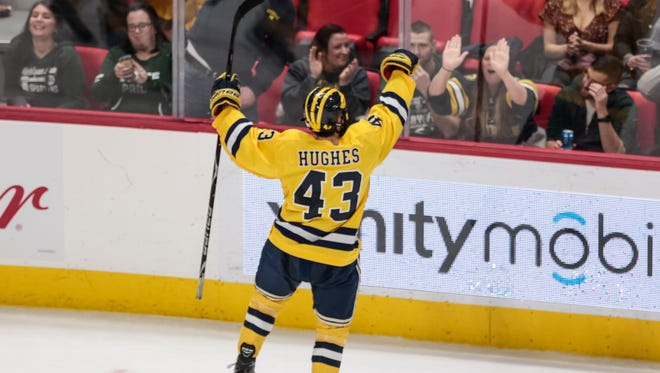 Michigan defenseman Quinn Hughes celebrates a goal during the third period against Michigan State at Little Caesars Arena in Detroit, Feb. 10, 2018.