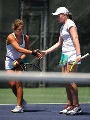 Kailey Evans (left), from Ennis, celebrates after winning