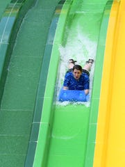 News Sentinel reporter Maggie Jones tries out new TailSpin racer water slide at Dollywood Thursday, May 18, 2017.