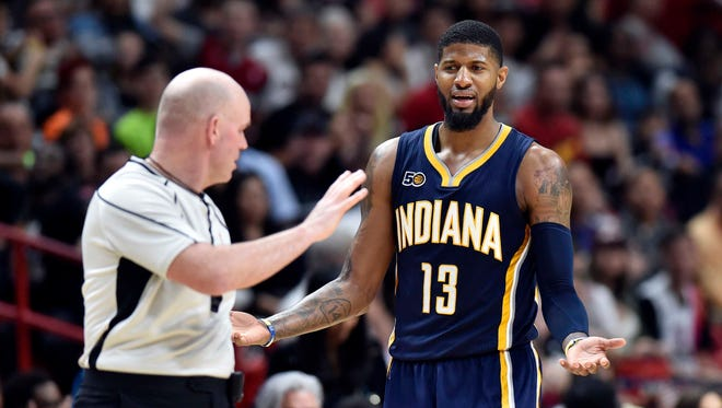 Indiana Pacers forward Paul George (13) reacts after reaching a double technical foul and then ejected from NBA referee Gary Zielinski (59) during the second half against the Miami Heat at American Airlines Arena.