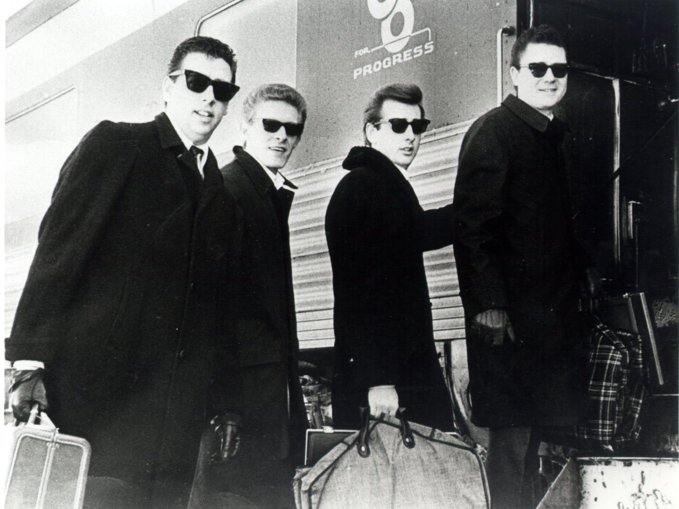 Harold, Phil, Don and Lew board a train in Staunton