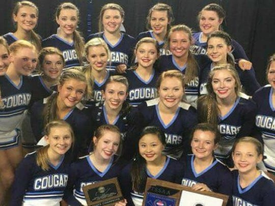 Centennial High's Centennial's varsity cheerleaders took home first place in the state Large Varsity competition.