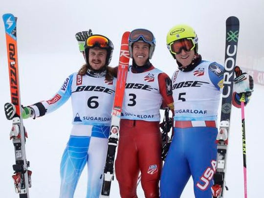 Hig Roberts, of Steamboat Springs, Colo., (3) smiles after winning the men's giant slalom skiing race at the U.S. Alpine Ski Championships at Sugarloaf Mountain Resort in Carrabassett Valley, Maine, Tuesday, March 28, 2017. With Roberts are second finisher Tim Jitloff, right, and third finisher Kieffer Christianson.