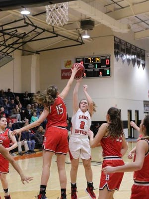 Hampshire's Kortney Rowland (15) blocks a shot by Jo Byrns' Ashlen Bryant during Monday's Region 5-A Tournament semifinal. Rowland scored a team-high 16 points in the Lady Hawks' 59-42 season-ending loss.