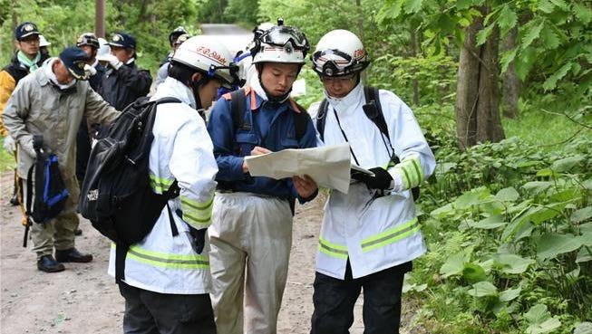 Rescuers continue the search near Nanae, Hokkaido.