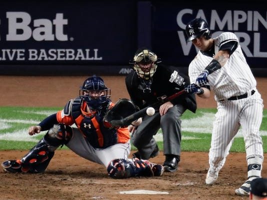 New York Yankees' Gary Sanchez hits a home run during the seventh inning of Game 5 of baseball's American League Championship Series against the Houston Astros Wednesday, Oct. 18, 2017, in New York. (AP Photo/Frank Franklin II)