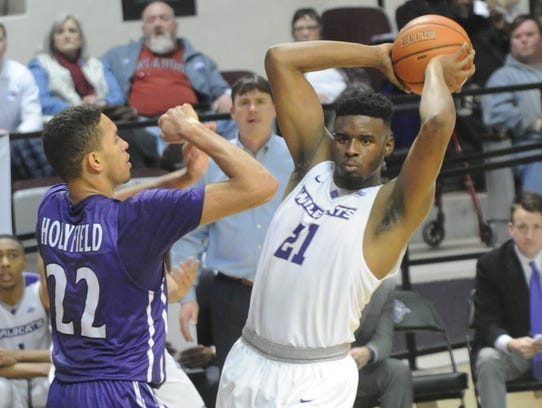 ACU's Jalone Friday (21) looks to pass the ball while